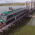 SMART Train entering Sonoma County via turntable bridge over Petaluma River