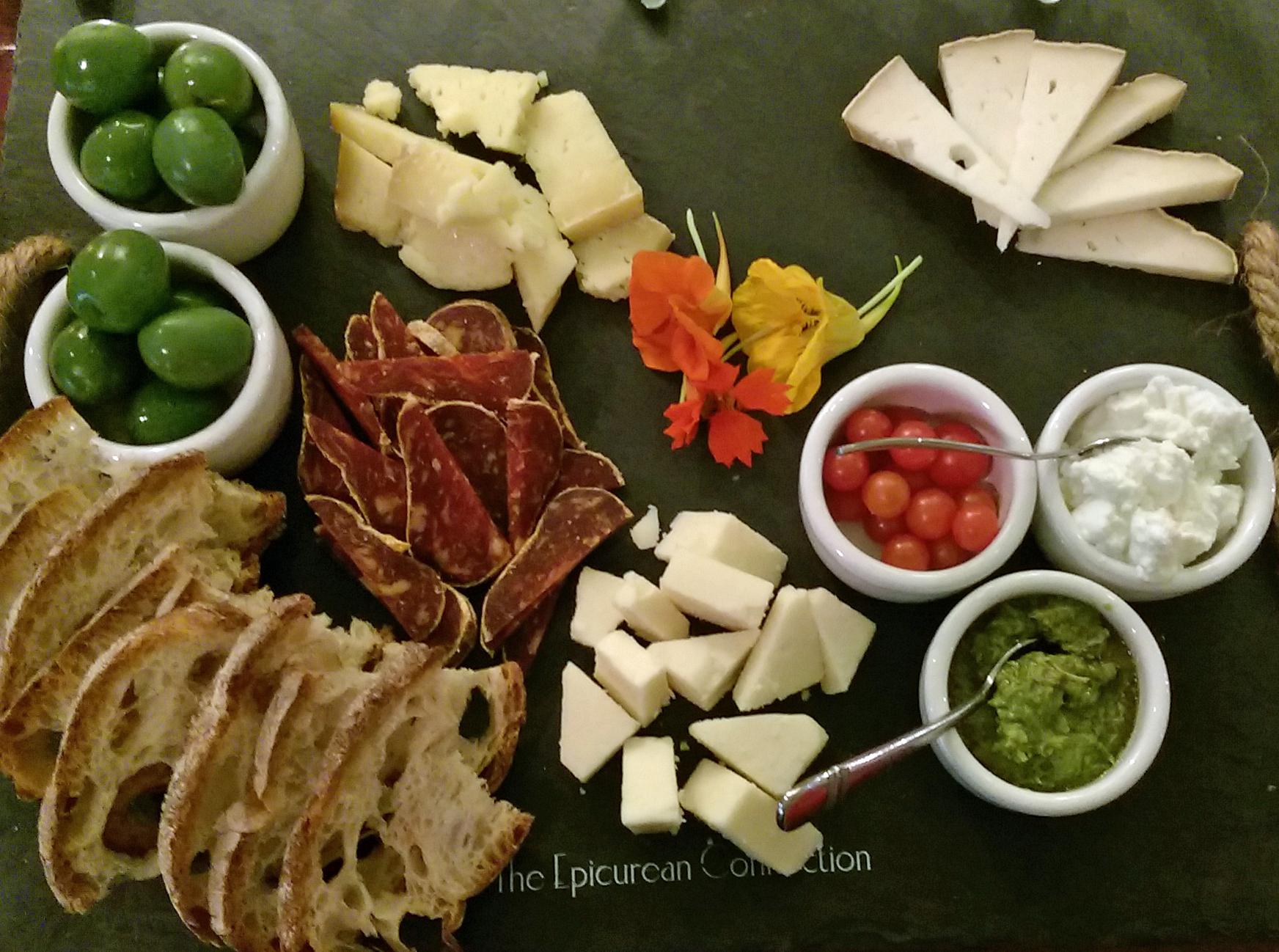 87319f40d A beautiful cheese plate at the Epicurean Connection complete with edible  nasturtium